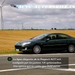 Peugeot 407 devant éoliennes